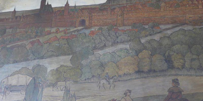 Bildnisse des Künstlers Hugo Friedrich Hartmann in der Bahnhofshalle Lüneburgs © Peter Pez